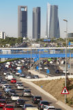 Traffic jam in Madrid with four towers skyline Royalty Free Stock Images