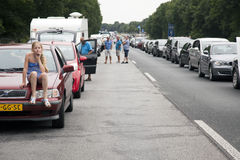 Traffic jam on motorway in germany. Girl sits on car during traffic jam on motorway in germany stock images