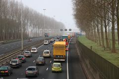 Traffic jam on motorway A20 at nieuwerkerk aan den IJssel as daily rush hour congestion. Traffic jam on motorway A20 at nieuwerkerk aan den IJssel as daily rush royalty free stock photo