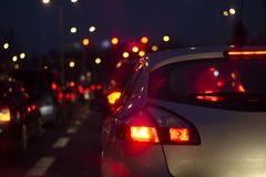 Traffic jam at night in a big city. Blurred Background royalty free stock photography