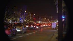 Traffic jam in night city, festive Christmas illumination decorating street. Stock footage stock video