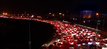 Traffic Jam at Night. A long trail of red brake lights seen in traffic jam at night in Mumbai. India royalty free stock image