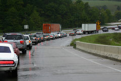 Traffic Jam on Rain Slick High. Traffic backed up during a rainstorm in northern Arkansas Royalty Free Stock Images