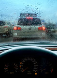 Traffic jam on rainy day. Traffic congestion or traffic jam through the windshield of a car on a rainy day Stock Image