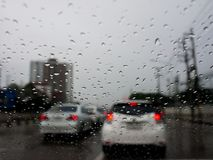 Traffic jam in rainy day with raindrops on car glasses royalty free stock photo