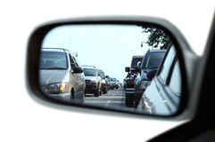 Traffic Jam on Rear View Mirror. Isolated on white background Stock Image