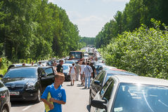 Traffic jam on road to military exhibition Stock Photos