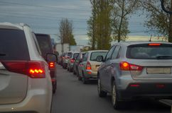 Traffic jam with row of cars on highway during rush hour. royalty free stock images
