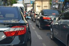 Traffic jam with row of cars during rush hour in a city street r. Oad Royalty Free Stock Photography