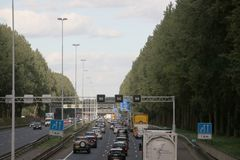 Traffic jam at rush hour on motorway A20 between Gouda and Rotterdam at Nieuwerkerk aan den IJssel in the Netherlands.  royalty free stock photography