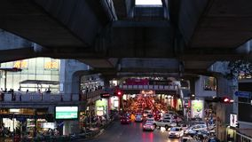 Traffic jam in the rush hour near the Siam BTS Station (Central Station), in the evening. stock video footage