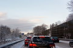Traffic jam on a snowy highway Stock Image