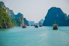 Traffic jam of traditional boats in Ha Long Bay royalty free stock image