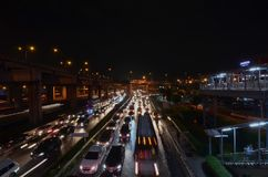 Traffic jam. At Samut prakan in Thailand, MEGA BANGNA at nigh after rain Royalty Free Stock Photo