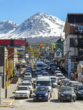Traffic jam in Ushuaia. Ushuaia, ARGENTINA - October 28: Traffic jam on street with mountain over the city, October 28, 2013 in Ushuaia, Argentina Royalty Free Stock Photo