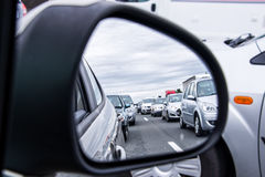 Traffic jam view through a car mirror Royalty Free Stock Image