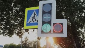 Traffic Laws. Countdown at the traffic lights, pointer additional sections, movement under the arrow. Blinking and. Changing color Red, and green modern traffic stock video