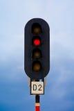 Traffic light. Semaphore - traffic light - on train station shot against blue, clouded sky Stock Photo
