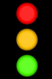 Traffic Light. Or Stop Light with Red Yellow and Green Illuminated Spheres with Copy Space Isolated on a Black Background Royalty Free Stock Photography