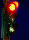 Traffic light. On the road on nighttime Stock Images