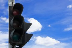 Traffic light. On blue sky background Stock Images