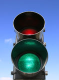 Traffic light. Green and red traffic light on blue sky background Stock Photography