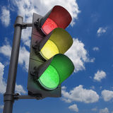 Traffic Light. In a blue sky with all the lights on Royalty Free Stock Photography