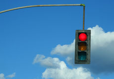 Traffic Light. A red traffic light against a sky Royalty Free Stock Photography