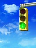 Traffic light. Green traffic light over a blue cloudy sky. Digital illustration Royalty Free Stock Image