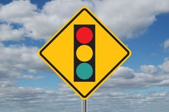 Traffic Light Ahead Sign with Clouds. In the background stock image