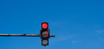 Traffic light with a beautiful blue sky Stock Images