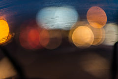 Traffic light blur. Abstract background blur generated by moving passed traffic lights including red, yellow or amber, white  and pale blue on black background Royalty Free Stock Photography