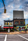 A traffic light and buildings on North Avenue in Baltimore, Mary Stock Image