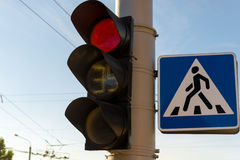 Traffic light with a burning red lights Stock Images