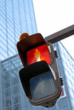 Traffic light in a city. Traffic light in don't walk stage in a big city-selective focus Stock Images
