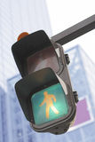 Traffic light in a city. Traffic light in Walk stage in a big city-selective focus Royalty Free Stock Images