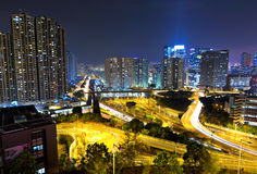 Traffic light through city Stock Photos