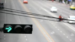 Traffic light on a city street and moving car.  stock footage