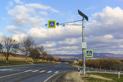 Traffic light complex solar and sign Royalty Free Stock Photos