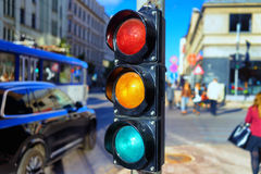 Traffic light at the crossroads. Pedestrians and tram at the crossroads with traffic lights in the city against the backdrop of facades of houses and tram rails royalty free stock image