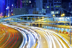 Traffic light curving lines on road during rush hour. It is a night view in Hong Kong royalty free stock photo