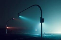 Traffic light in the dark night. Beautiful lighting effects in the dark misty night Royalty Free Stock Photo