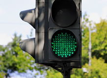 Traffic light. The device directs traffic, sign lights up green Stock Photography