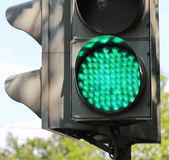 Traffic light. The device directs traffic, sign lights up green Stock Photo