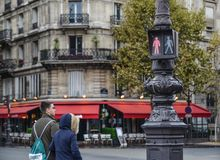 Traffic light at downtown of Paris, France stock photo