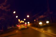 Traffic light of driving car on city night street road Stock Photo