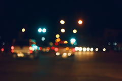 Traffic light of driving car on city night street road Royalty Free Stock Photos