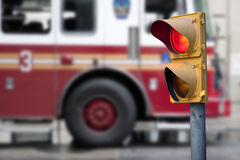 Traffic light with fire engine Royalty Free Stock Images