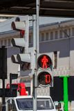 Traffic light with forbidding red signal for pedestrians on the city street closeup royalty free stock photography