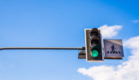 Traffic light in front of blue sky Royalty Free Stock Photos